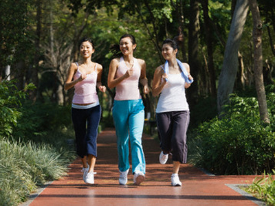Young Women Power Walking --- Image by © Redlink Production/Corbis